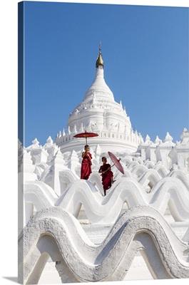 Two Buddhist novice monks on the white pagoda of Hsinbyume (Myatheindan) paya temple