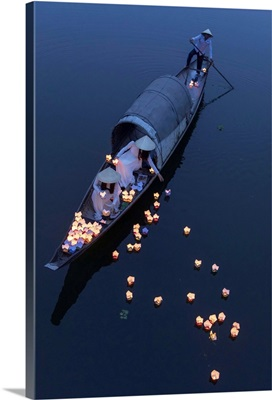 Vietnamese Girls Drop Floating Candles On A River In Hue To Pray For The Dead, Vietnam