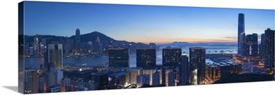 View of Hong Kong Island and Tsim Sha Tsui skylines at sunset, Hong Kong