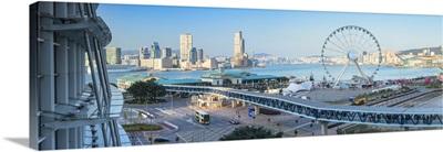 View of Star Ferry pier, observation wheel and Tsim Sha Tsui skyline, Hong Kong, China