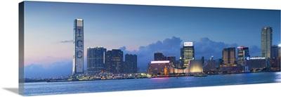 View of Tsim Sha Tsui skyline at dusk, Hong Kong, China