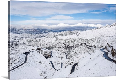 Winding road through Tizi N'Tichka pass in the Atlas Mountains during winter snow