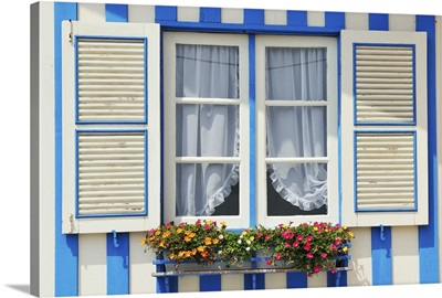 Window of a traditional striped house in the seaside village of Costa Nova, Portugal