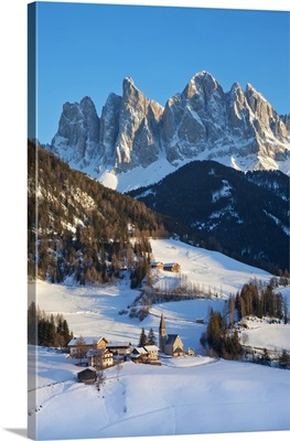 Winter landscape of St. Magdalena village and church, Italy, Europe