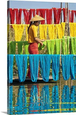 Woman Hanging Dyed Yarn From A Boat To Dry, Lake Inle, Myanmar