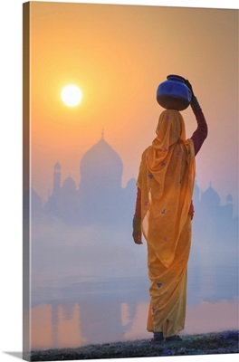 Woman On A Foggy Morning With The Sun Rising On The Taj Mahal, India