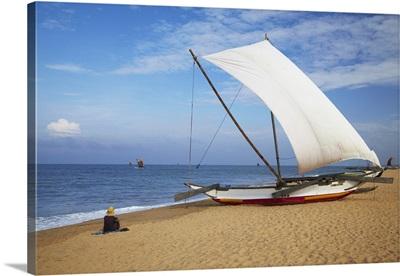 Woman on beach, Negombo, Sri Lanka