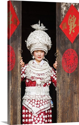 Young Miao woman wearing traditional costumes and silver jewellery, Guizhou, China