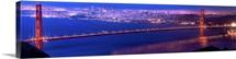 Golden Gate Brige with Bay Bridge Illuminated in Background