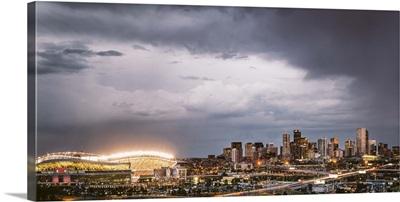 Sun sets over Denver during a Bronco's football game, Denver, Colorado