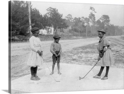 African American Children Playing Golf