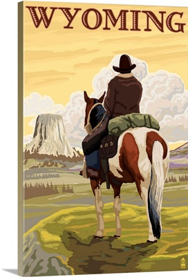 Cowboy and Devil's Tower - Wyoming: Retro Travel Poster