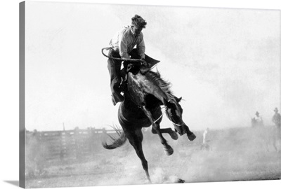 Cowboy riding Bronco in Rodeo, Burns, OR
