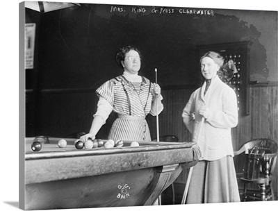 Two Women Playing Billiards at Pool Hall
