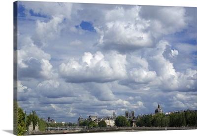 Paris skyline under a cloudy sky