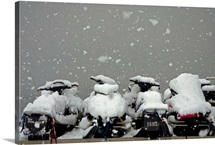 Snow covered snowmobiles, Alaska