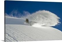 Snowboarder kicking up fresh powder, Valdez, Alaska
