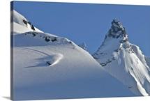 Snowboarder racing down mountainside, Valdez, Alaska