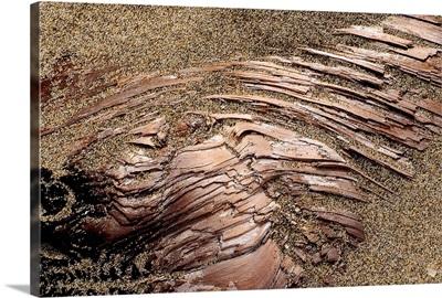 Sand over Layered Bronze Rock