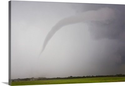 A long and skinny tornado forms from a supercell thunderstorm