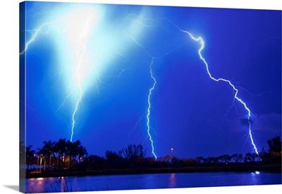 An intense nighttime thunderstorm emitting multiple large lightning bolts