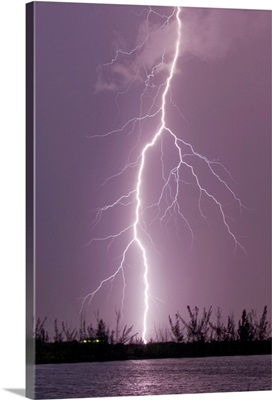 Cloud to ground lightning strike during intense summer thunderstorm