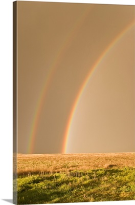 Double rainbows on the backside of a thunderstorm in Tornado Alley