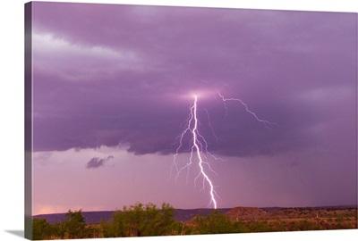 Intense purple lightning bolts strike in the desert of New Mexico