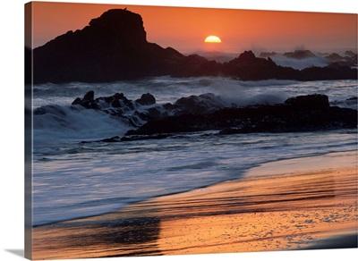 Crashing surf on rocks at sunset, Point Piedras Blancas, California