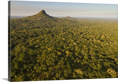 Inselberg rock formations rising above rainforest, Gorongosa National Park, Mozambique