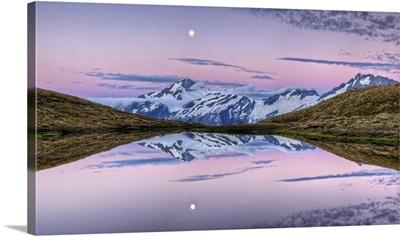 Moonrise at dusk over Cascade Saddle, Mount Aspiring National Park, New Zealand