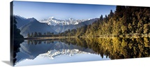Mount Cook and Mount Tasman reflected in Lake Matheson near Fox Glacier, New Zealand