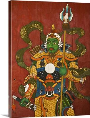 Mural of Buddhist guardian on hotel door, Ulan Baatar, Mongolia
