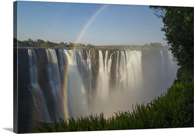 Rainbows formed in mist from waterfall, Victoria Falls, Zimbabwe
