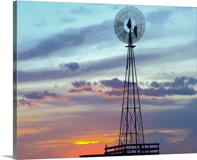 Windmill producing electricity at sunset example of renewable energy, North America
