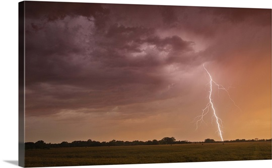 A cloud-to-ground bolt of lightning strikes beneath a thunderstorm ...