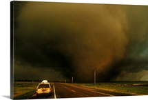 A massive F4 category tornado bears down on a storm chasers van