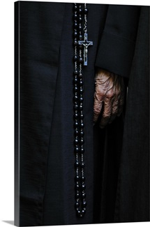 A rosary hangs from the dress of a nun from Our Lady of Fatima