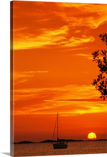A sailboat silhouetted by a brilliant orange sunset in Florida Bay, Florida