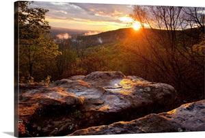 A Warm Glowing Sunset Over Mountain Ridges Wall Art