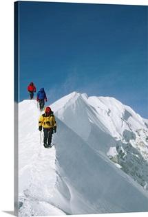 Climbers hike along a ridge on their way up Denali