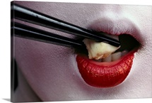 Geisha eating tofu with chopsticks, Japan