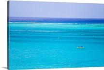 Kayakers in the turquoise waters of Grace Bay, in the Turks and Caicos Islands