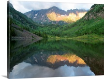 Morning light on Maroon Bells, reflected in Maroon Lake, Colorado