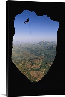 Rappelling in the bullet hole on Poi, Ndoto Mountains, Northern Frontier District, Kenya
