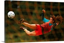 Soccer player suspended in air
