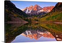 The Maroon Bells glow in the early morning light