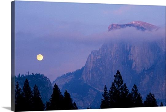 The moon rises over Half dome in Yosemite National Park, California