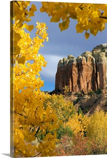 The yellow leaves of fall frame a rock formation, Santa Fe, New Mexico