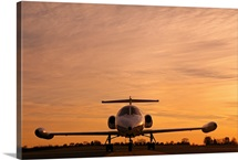 Twilight view of a Lear jet on the runway, Maryland
